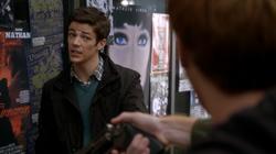 Posters behind Barry Allen