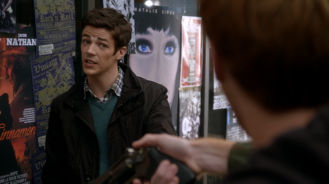 File:Posters behind Barry Allen.png