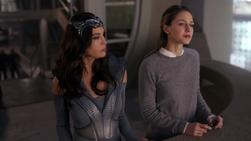 Kara speaking with Rhea