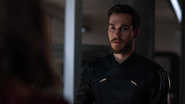 Mon-El in the Legion suit