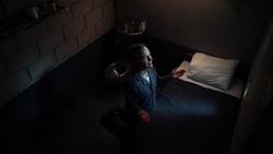 Thomas Coville praying in prison