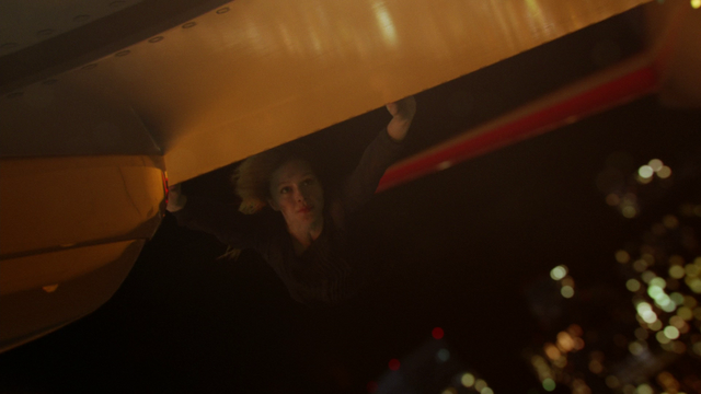 File:Kara hanging onto the wing of the Flight 237 plane.png