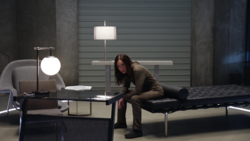 Nora in prison at the Time Bureau