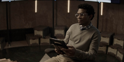 Luke smiles reading an article on Batman's supposed return