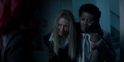 Julia and Luke are released from Alice's captivity and escape Arkham