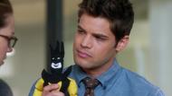 Winn Schott holding his father's Toyman doll