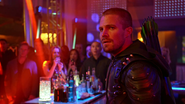 Oliver as the Green Arrow unmasked