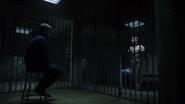 Oliver imprisons Slade in Lian Yu