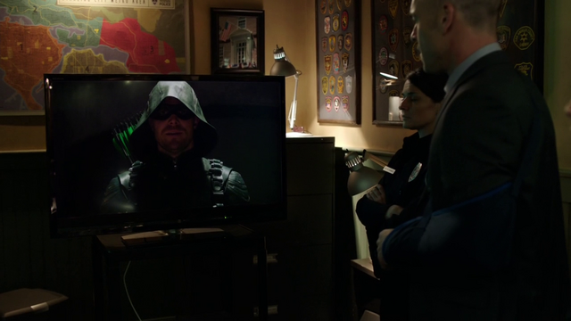 File:Oliver broadcasts his opening speech as the Green Arrow.png