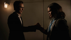 Eobard and Cisco try to do a handshake