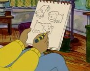 Arthur drawing dogs