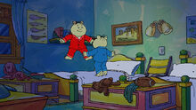 Tommy and Timmy Tibble jumping in bed