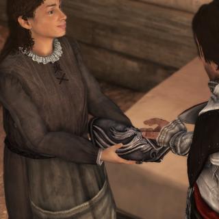 从玛格丽塔那里接过新护腕的埃齐奥