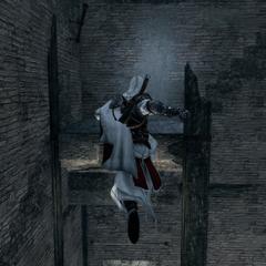 Ezio escaladant la tour