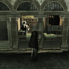 Ezio achetant des remèdes chez un médecin