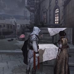 Ezio legt het plant uit aan Cristina