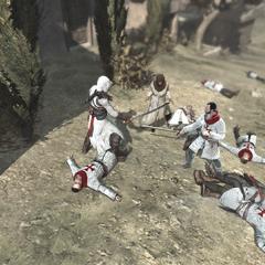 Altaïr combattant dans le village