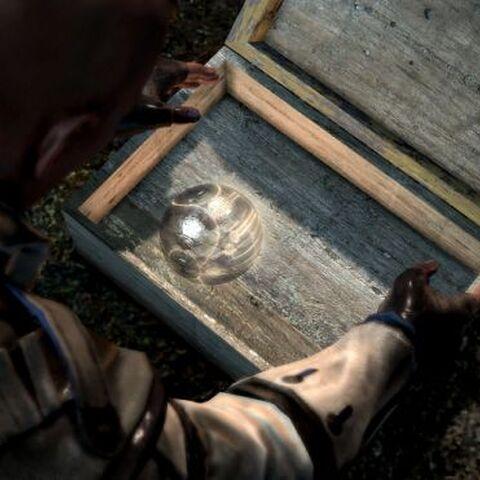 Connor récupérant une boule de cristal de son village natal