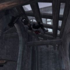Een lamp begeeft het onder Ezio's gewicht.