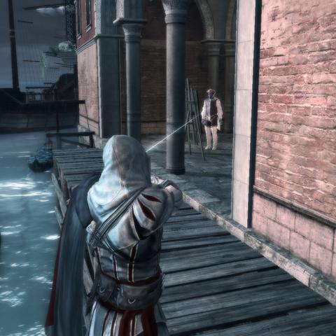 Ezio exécutant sa cible au <a href=