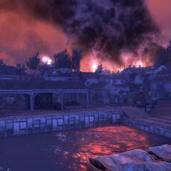 夜晚的查爾斯鎮,遠處正有一場衝突爆發