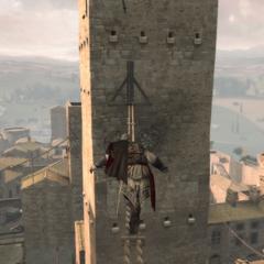Ezio beklimt de toren.