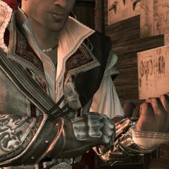 Ezio ajustant le mécanisme du pistolet