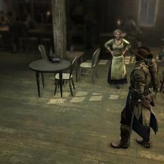 Connor entrant dans la <b>taverne</b>