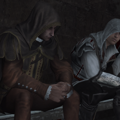 Ezio et La Volpe discutant.