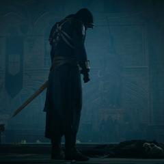 Arno se tenant auprès du squelette de Germain