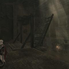 Ezio abaissant le pont aux mercenaires