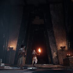 Bayek et Aya devant la porte ouverte de la crypte