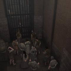 入口前被拒绝进入的一群佣人