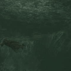 Ezio diving into a pond beneath the fortress in <a href=
