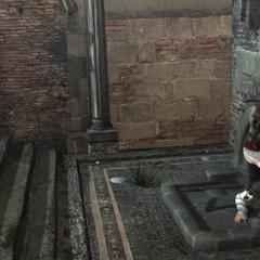 Ezio pénétrant dans la Tanière de Romulus