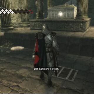 Ezio steht vor Amunets Sarkophag