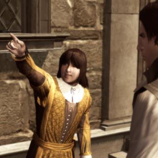Petruccio wijst naar de veren die hij wilt.
