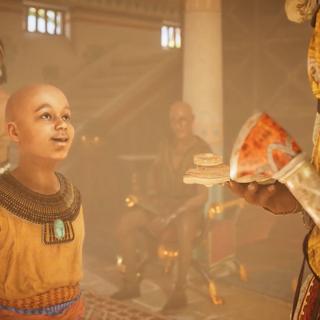 Kawab confiant son jouet à Bayek