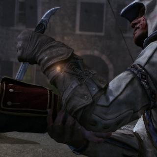 Connor plantant sa <b>lame secrète</b> dans le bras d'<a href=