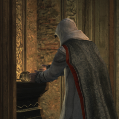 Altaïr sealing the Apple beneath the fortress in Masyaf