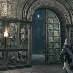 Ezio bij de ingang van de basiliek.