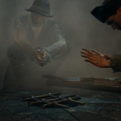 Les mendiants se réchauffant les mains auprès d'une cheminée