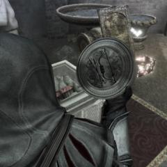 Ezio récupérant le sceau de Qulan Gal