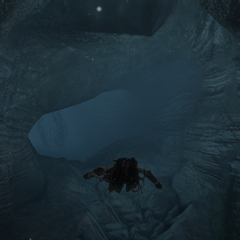Aveline swimming through an underwater cave