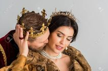 139816547-king-with-crown-hugging-and-kissing-attractive-queen-isolated-on-grey