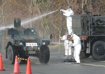 23.3.31 CRF:情報収集後の装甲車の除染(JV) 東日本大震災における災害派遣活動 23