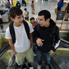 Austin Mahone, left, and his friend, Robert Villanueva, ride an escalator at Northpark Mall on Saturday, Nov. 19, 2011