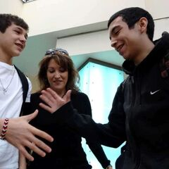 Austin Mahone, left, greets his longtime friend, Robert Villanueva, as his mother, <a href=