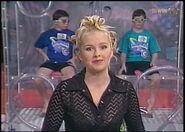Zoe sheridan behind the 2 captians inside the tanks