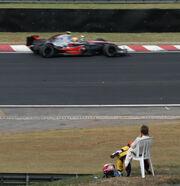 Heikki Kovalainen watching 2007 Brazil GP